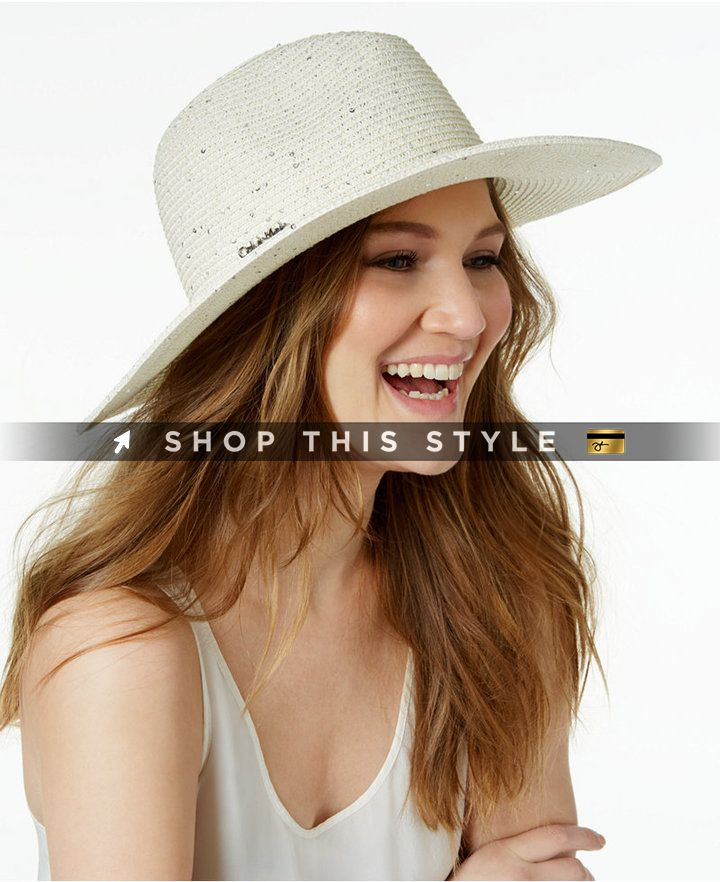 48792691 A sprinkling of sequins adds a fun touch to this stylish straw panama hat  from Calvin Klein featuring a wide sun-shielding brim. #CalvinKlein #Hats  #Ivory