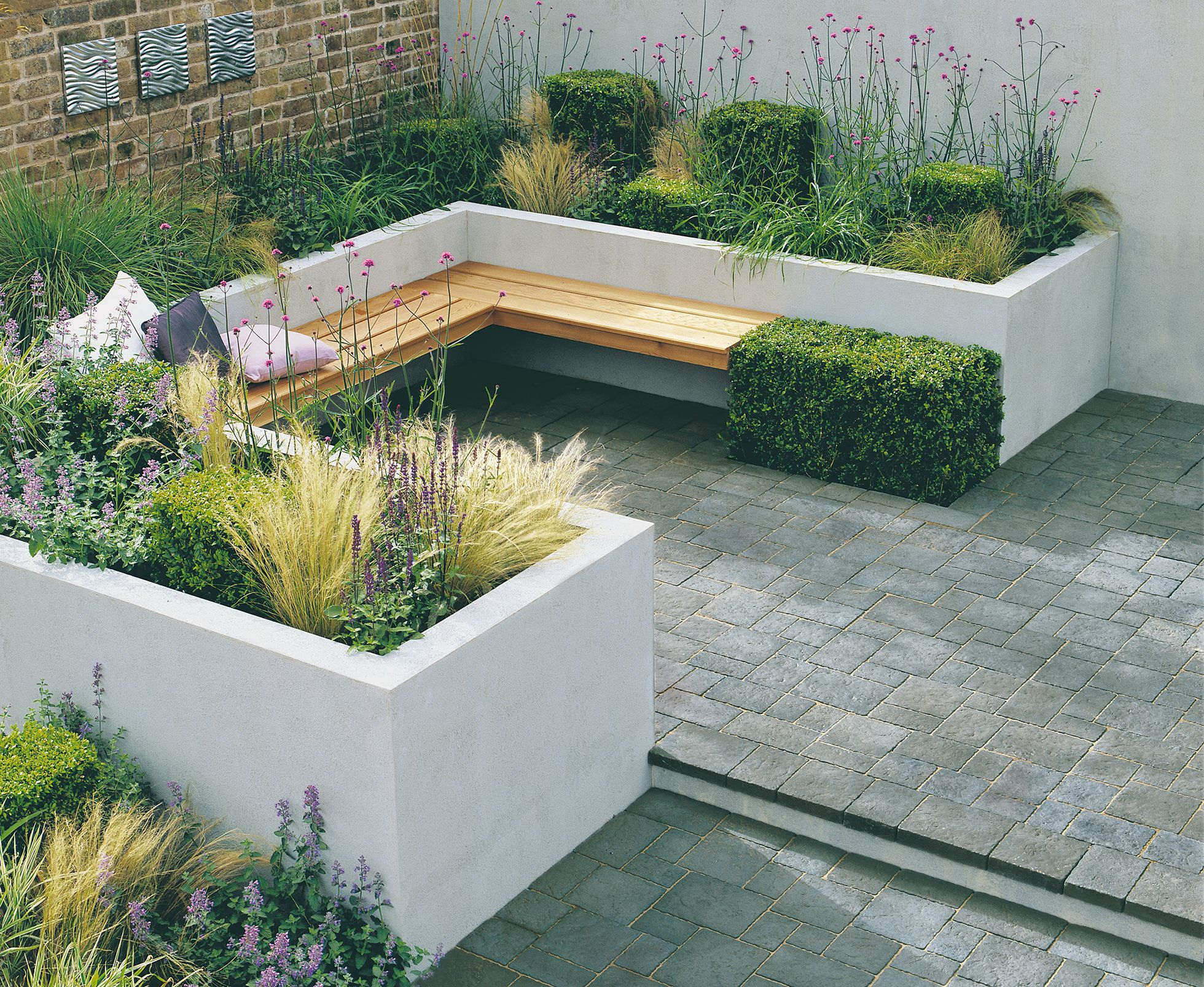 Garden seating and planters made from rendered block for Garden sectioning ideas
