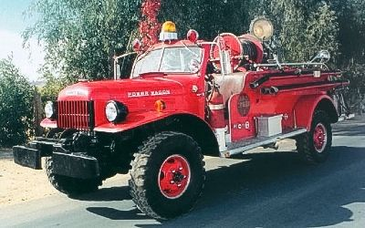 A Classic 1955 Dodge With A Howe Fire Truck Body On Display In
