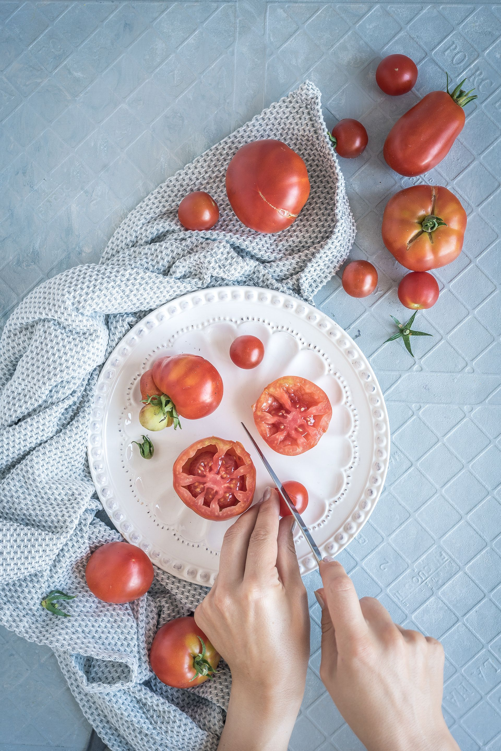 Slicing Tomatoes On A Grey And Blue Backdrop Healthylaura Food Photography Foodphotogra Rustic Food Photography Healthy Food Photography Food Photography