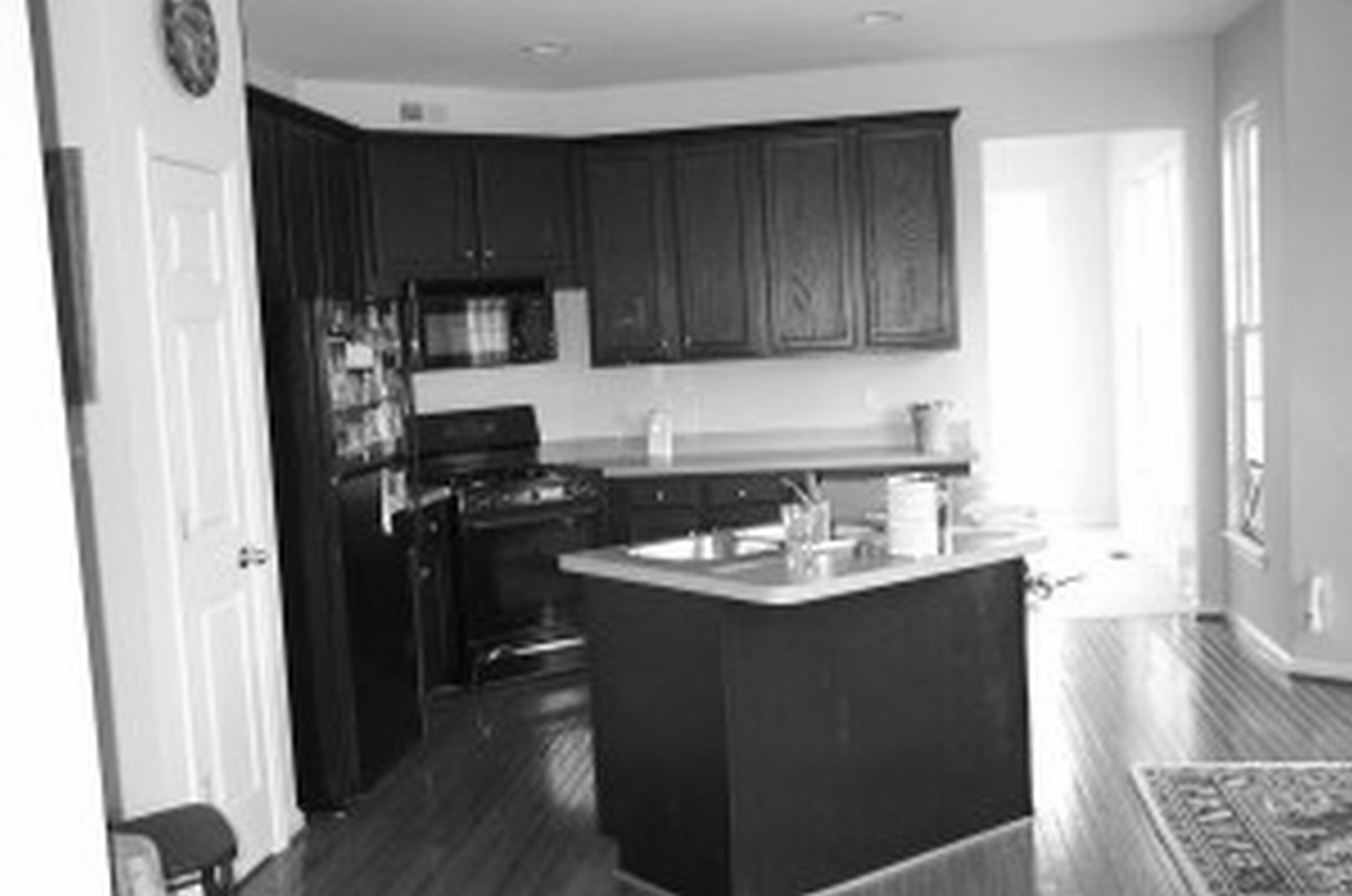 Kitchens with Dark Cabinets and Black Appliances black kitchen