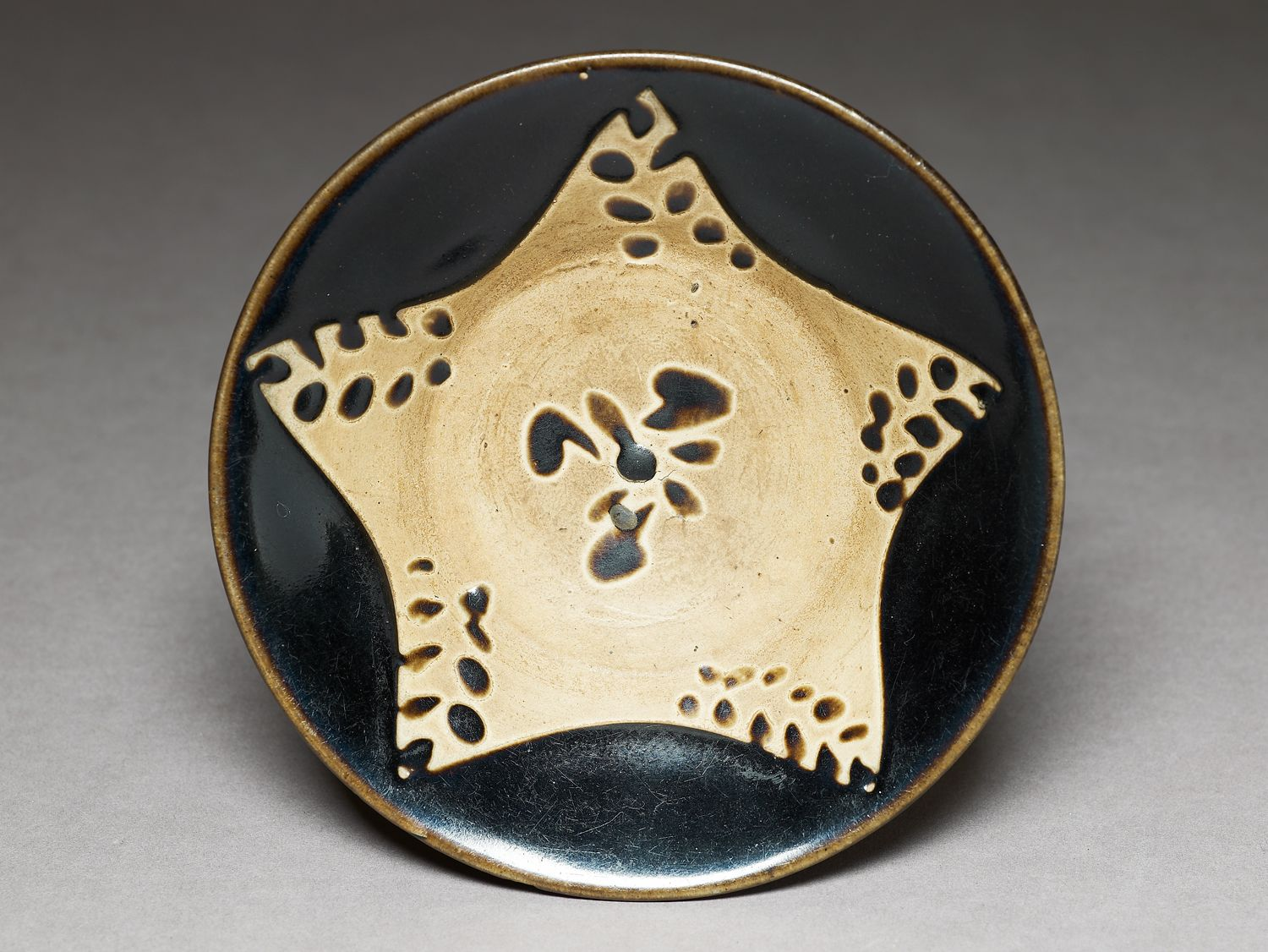 Ashmolean Advent Calendar Day 9 - Star on a black ware bowl - Yaozhou kilns, China, 11th Century - EA1956.1427 © Ashmolean Museum - Read more, and see similar objects, at: http://jameelcentre.ashmolean.org/object/EA1956.1427