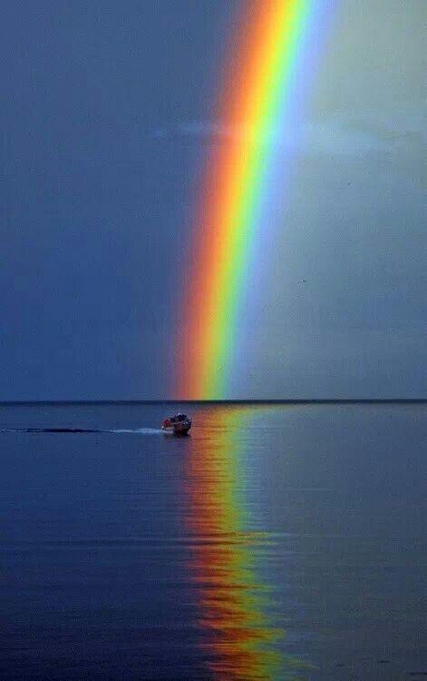 Rainbow over water.