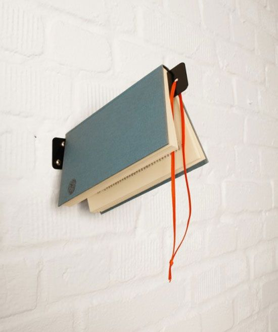 Creative Bookshelf That Also Serves As A Bookmark. would be neat hanging next to a stack of books on one of those invisible bookshelves, very functional wall art
