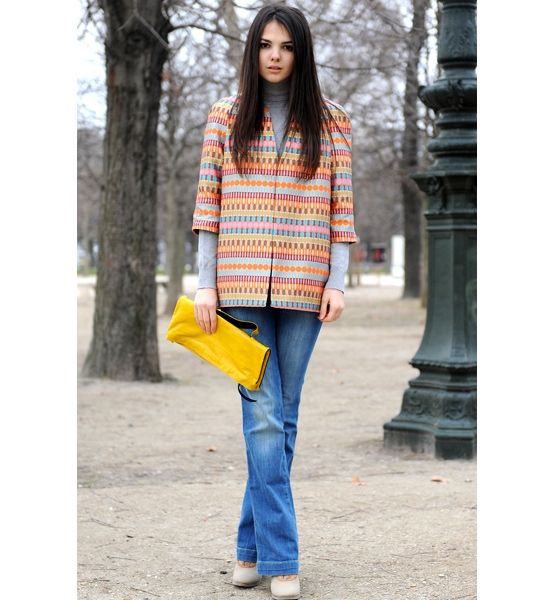 In Print  A colorfully printed coat adds visual interest to any timeless outfit.