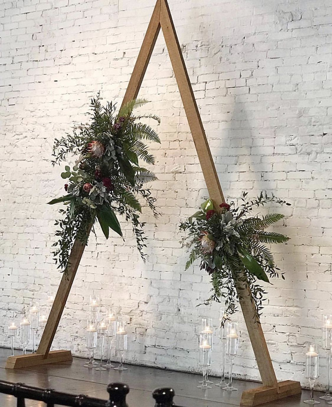 Wedding Arch Diy Candle Centerpieces Bohemian White Brick Wall With Industrial And Urban With Boho Style T Diy Wedding Arch Wedding Arch Winter Wedding Arch