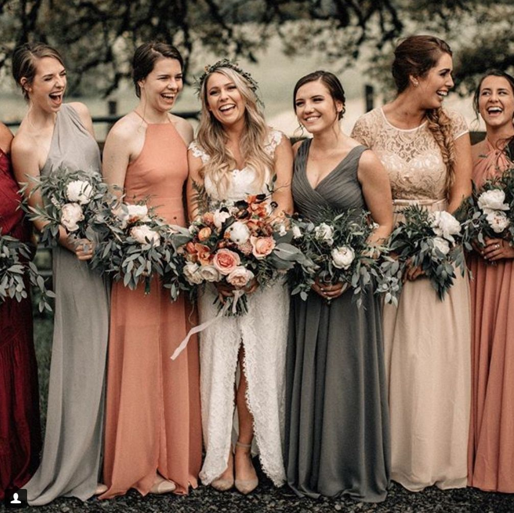 Mismatched Bridesmaid Dresses Using A Muted Colour Palette Of Greys Neutrals And Red Orange Bridesmaid Dresses Bridesmaid Dress Colors Orange Wedding Colors
