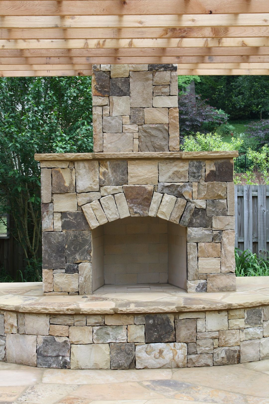 Outdoor stone fireplace with pergola for the outdoors for Outdoor stone fireplace designs
