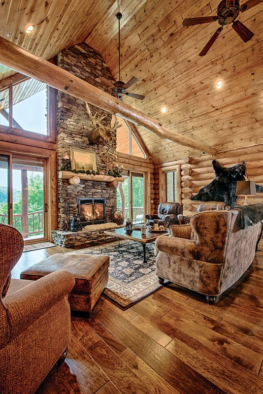 Great room unique wood flooring fireplace flat feature wall interior dowell golden eagle log homes also  mountain home in new hampshire architecture  adore rh pinterest