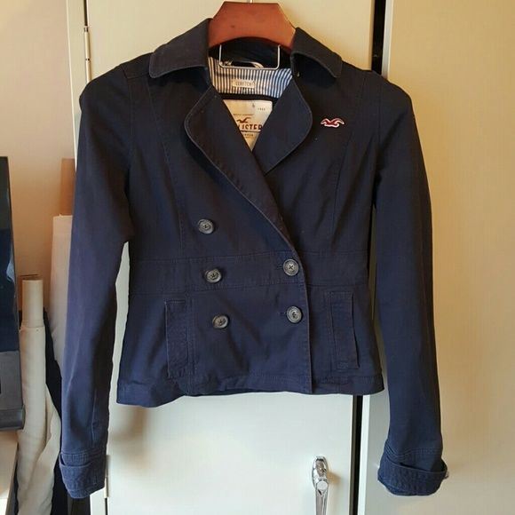 Hollister Double Breasted Jacket Navy stretch twill jacket with striped contrast lining. It is missing one logo button.  Don't really notice it because lapel overlaps so high. 98% cotton,  2% elastane.  Lining is 100% cotton. Hollister Jackets & Coats Pea Coats