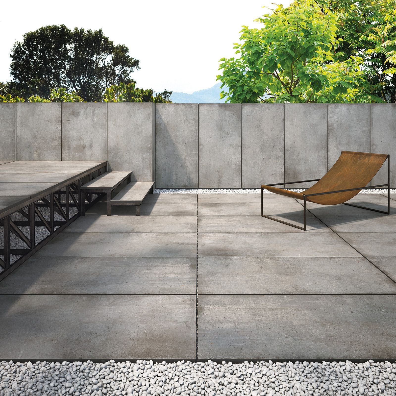 Industrial Inspired Garden Terrace, Featuring Large Format Patio Slabs.  Concrete Effect With Modern Garden