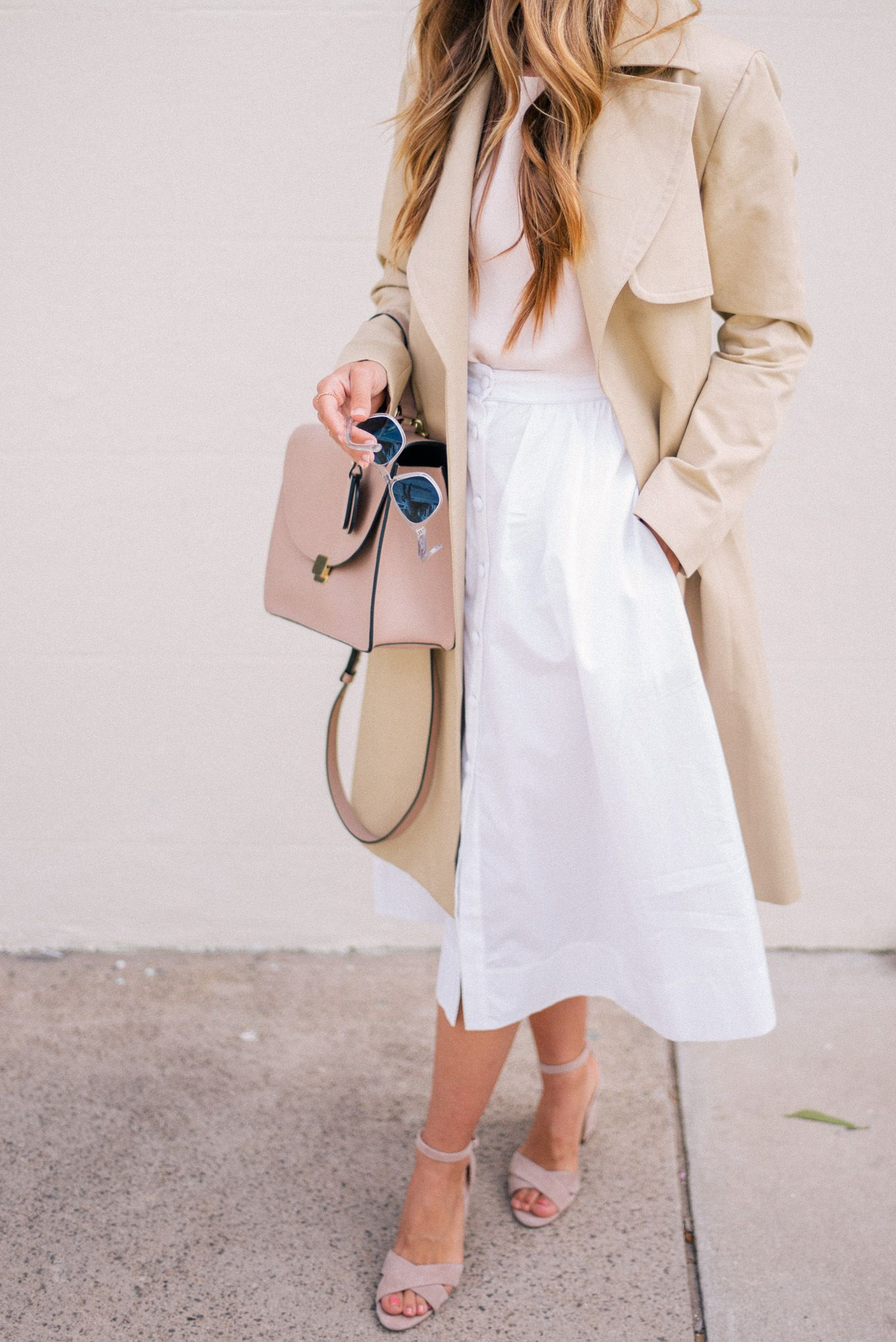 White skirt + trench coat.