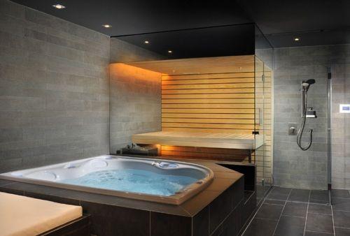 bathroom with a hot tub and sauna! waaanntt. *ifyoulikemystufffollowme :)*