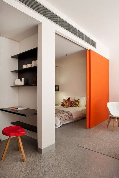 Sliding door for privacy tiny flat apartment studio bedroom modern style, bright colors, clean neat and tidy, minimalist lifestyle.