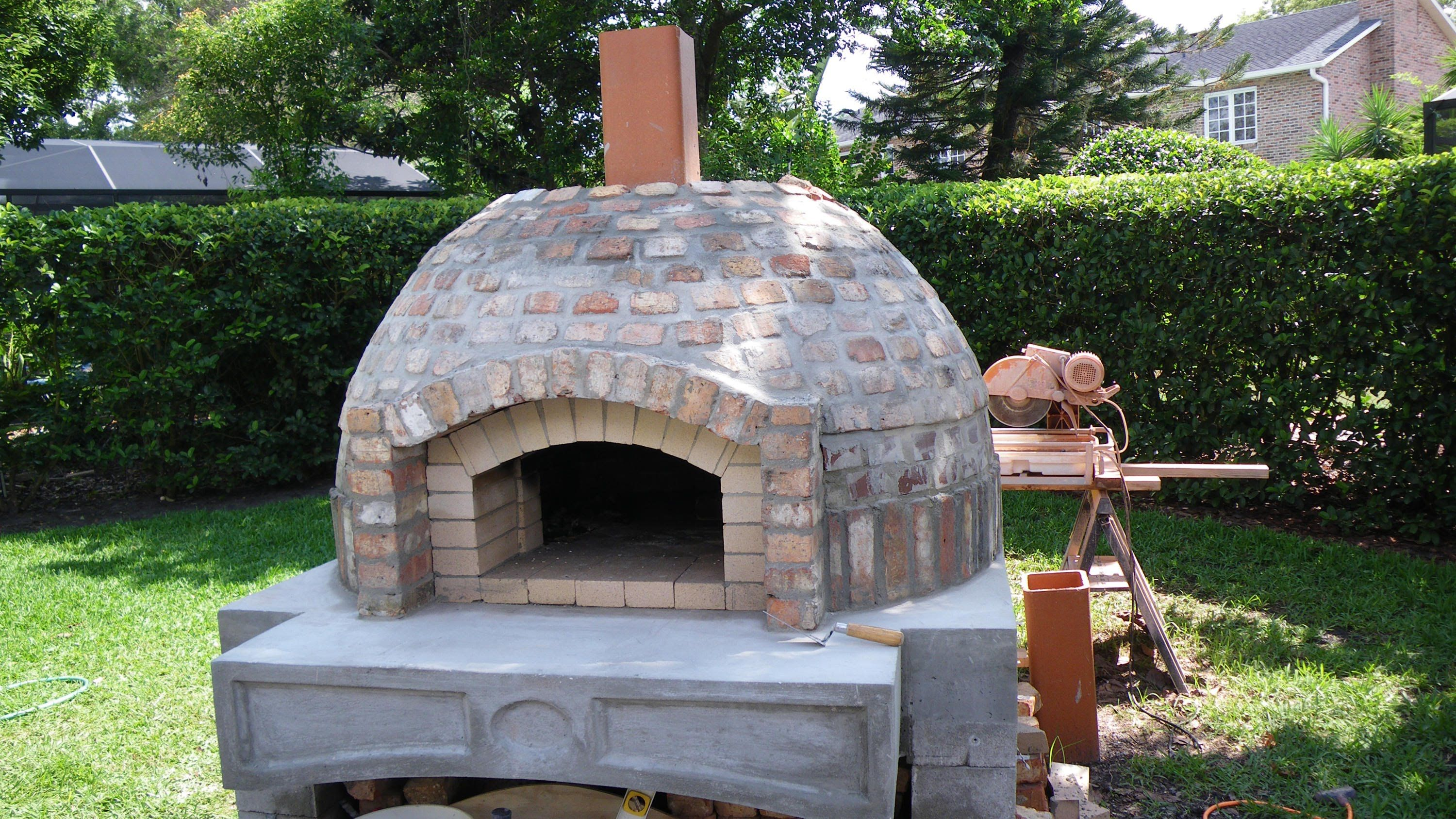 Outdoor Kitchen With Smoker And Pizza Oven