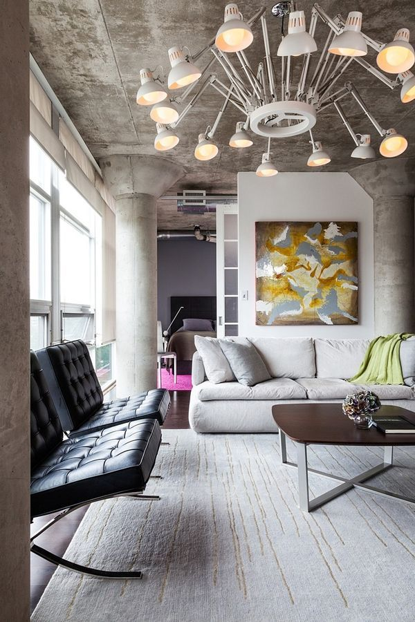 This rather brutal loft with cool industrial features and details is loft 002 by rad design in toronto in trendy king west area the loft was created for