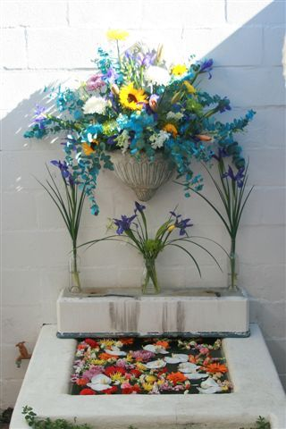 Floating orchids and other flowers, Irises in glass bottles and the Focal Arrangement.