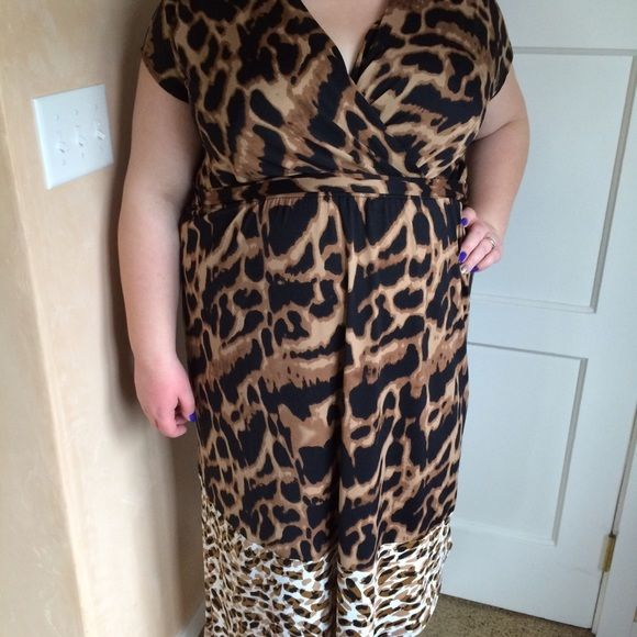 Leopard dress Very beautiful dress! It has a surplice neckline. Banded under the chest. It ties around. The hem is asymmetrical. Brand new with tags. It's about a midi length on me. I'm modeling as 18/20, 40 f/g, 5'7. Hot in Hollywood Dresses