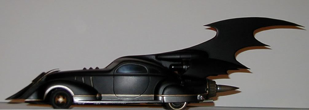 I thought I'd show off my only custom Batmobile here.   Not being a car modeler by trade, I can't compete with those that can do such great work on the Barris cars etc., but I did try hard on this