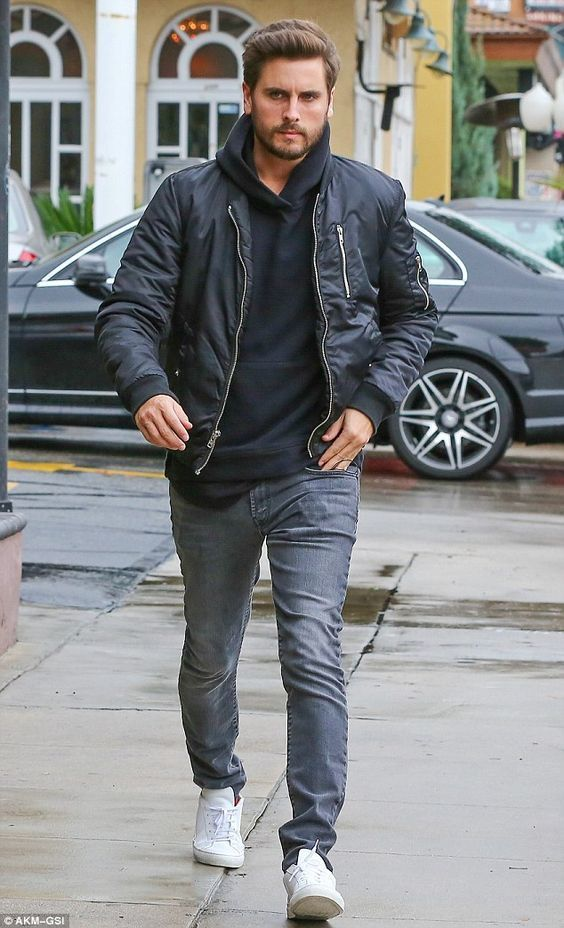 Scott Disick wearing Black Bomber Jacket, Black Hoodie, Grey Jeans ...