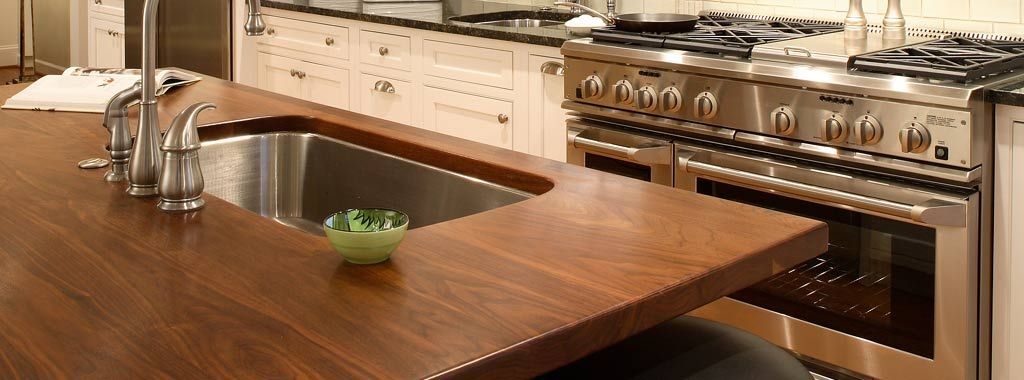 A J. Aaron wood countertop or kitchen island top is sealed to protect it from water damage so it's safe to use a stylish undermount sink.