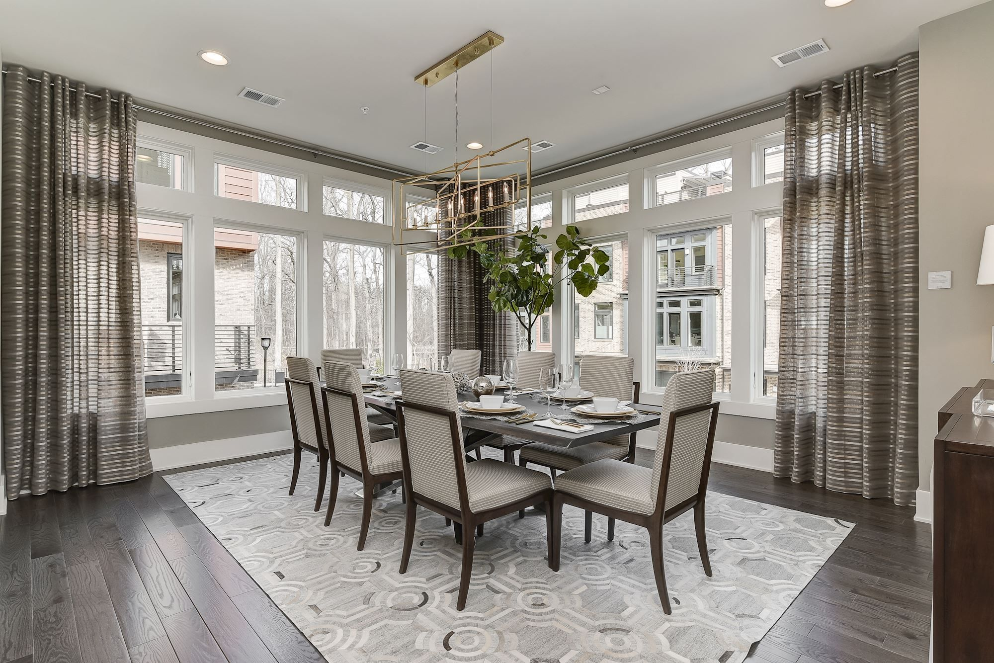 Modern Dining Room With Mixture Of Gray And Earth Tones Sleek Gold Light Fixture