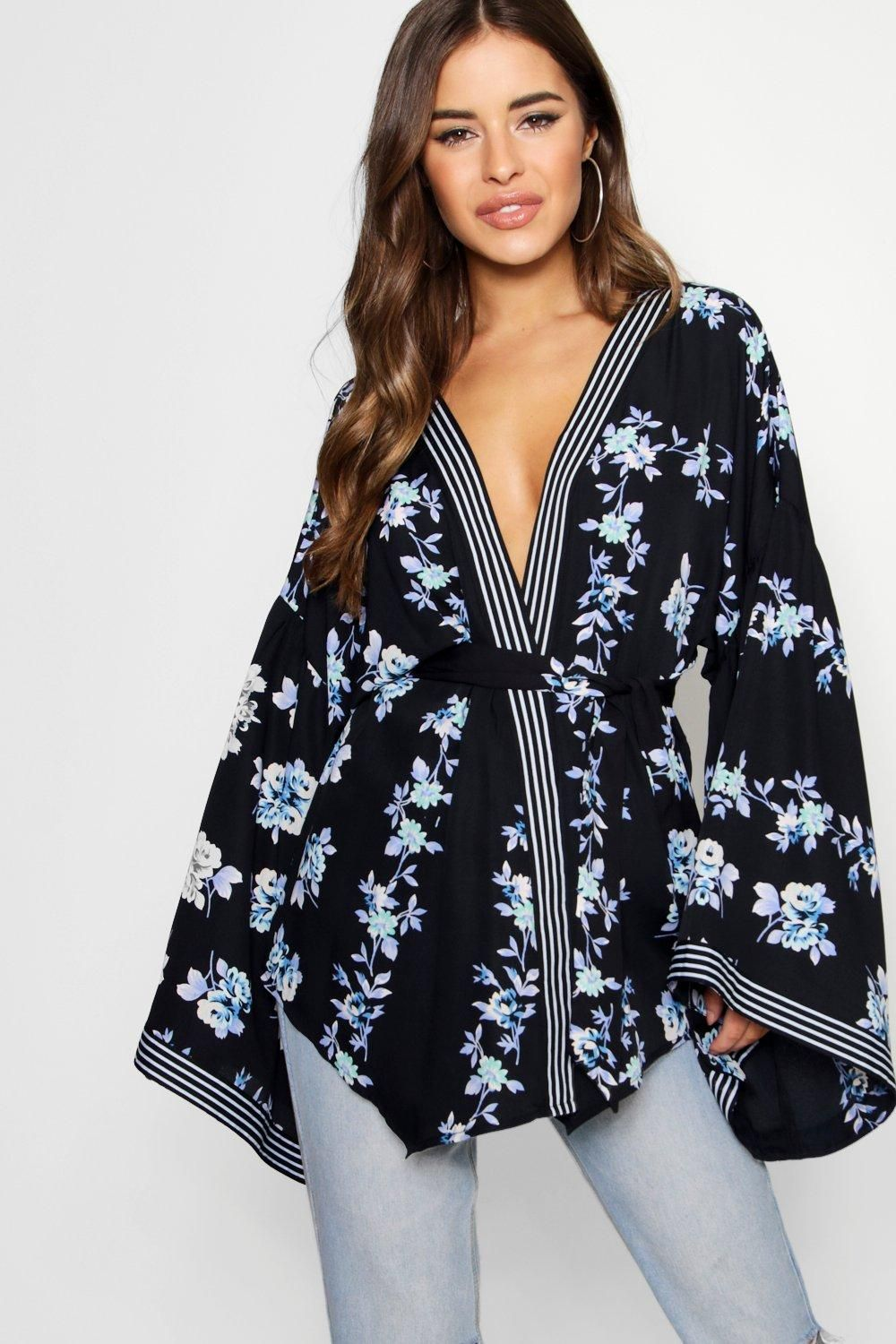 6a9ebf31b5 Click here to find out about the Petite Jessica Border Print Kimono Sleeve  Wrap Top from Boohoo