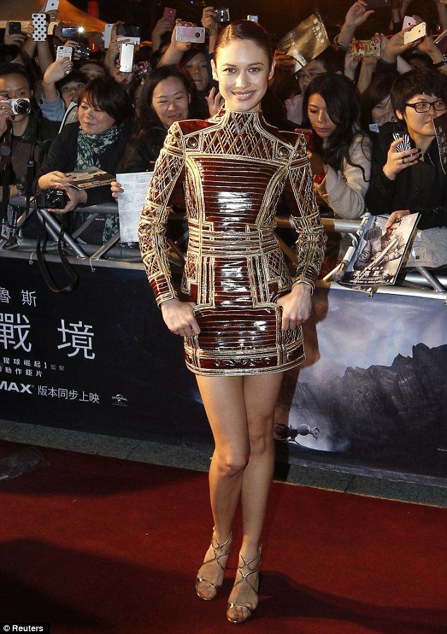 Sheu0027s Part Of The Furniture! Olga Kurylenko Wears Bizarre Gold And  Varnished Wood Mini Dress To Taiwan Premiere Of Oblivion