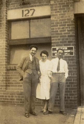 Digital Photograph - Two Men & One Woman outside Bush's Confectionary Factory, Richmond, circa 1935