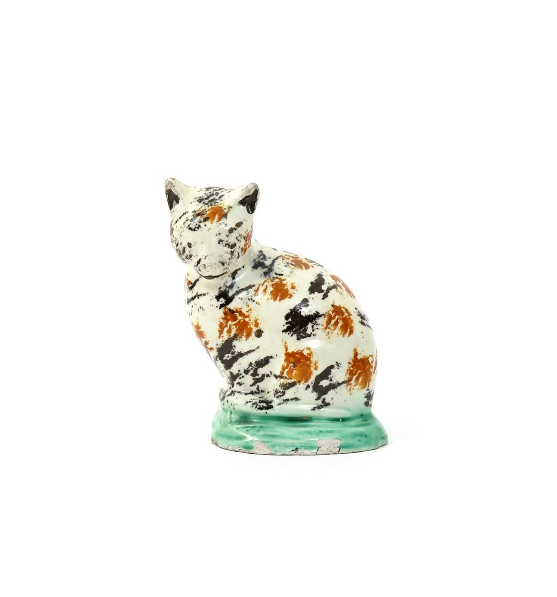 Lot 99 - A Staffordshire creamware model of a cat c 1800