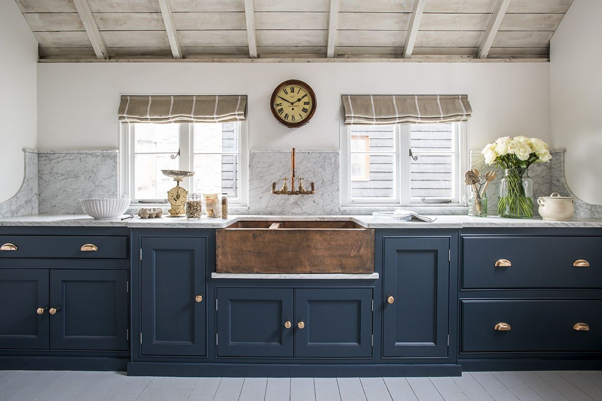The Copper Sink And Dark Blue Cabinetry Create Stunning Atmosphere