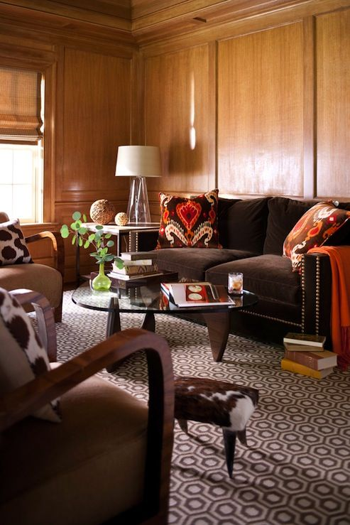 Dens Libraries Offices Brown Orange Ikat Pillows Chocolate Velvet Sofa Nailhead Trim Throw Noguchi Walnut Table Wood Paneling Cowhide Foot