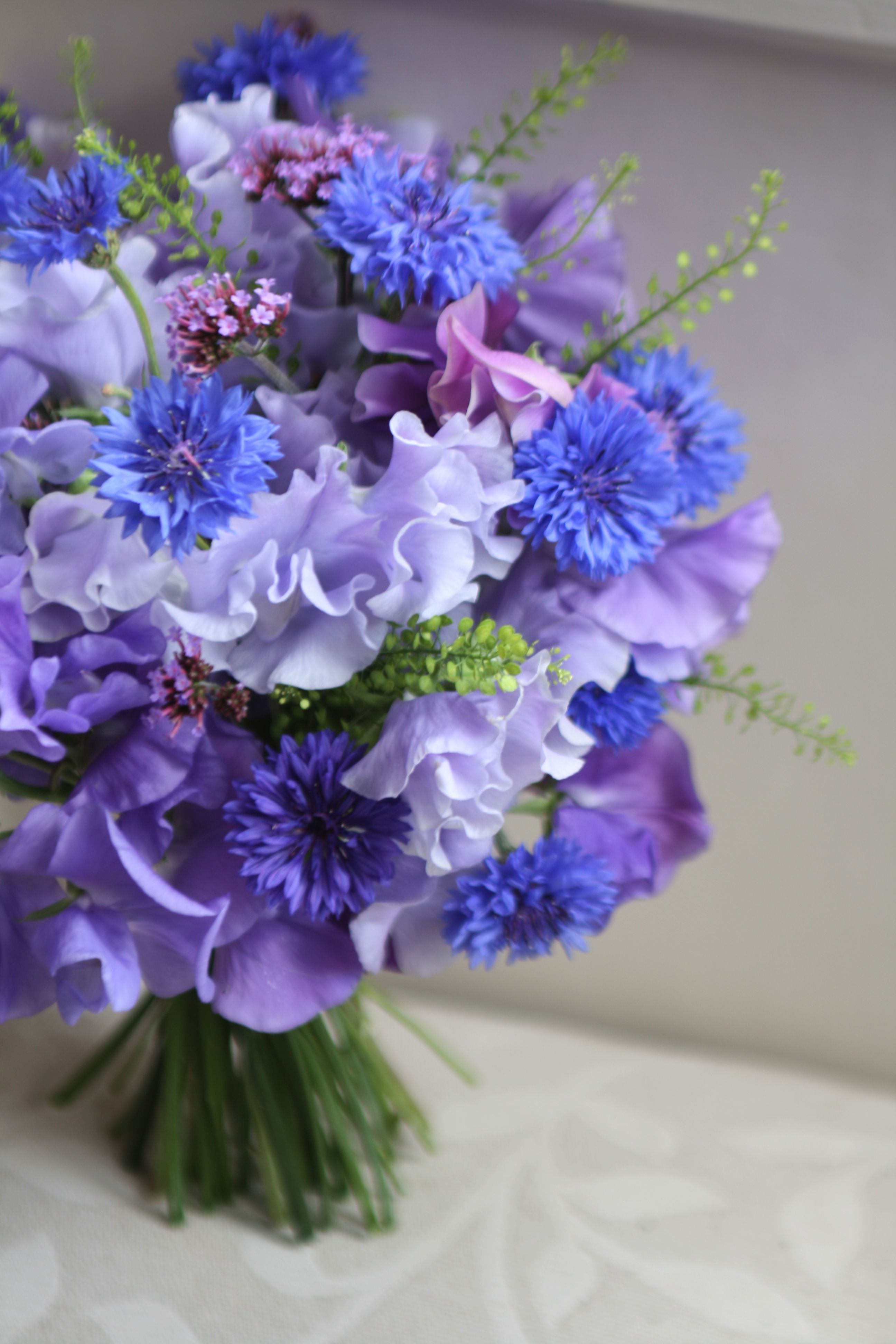 Bouquet Of Home Grown Sweet Peas And Verbena With Cornflower And Thlaspi Foliage Liberty Blooms Sweet Pea Bouquet Wedding Flowers Purple Flowers