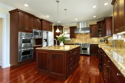 dark wood cabinets, beige countertops