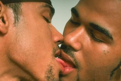 Two black men kissing