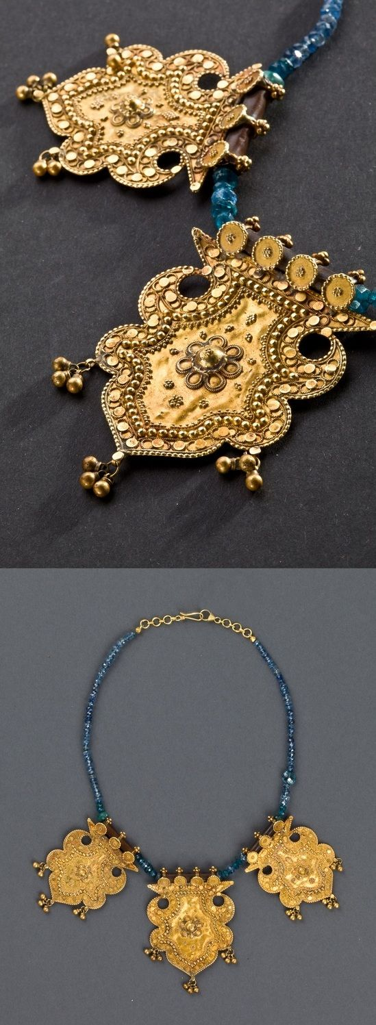 India necklace with three thick gold pendants decorated with