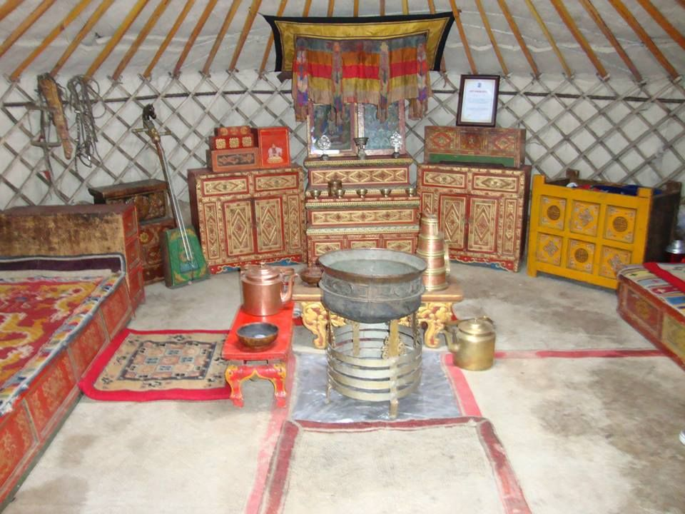 Inside a mongolian yurt, with very beautifully painted