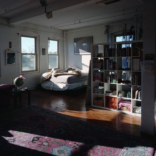 This is exactly how I always pictured my downtown studio loft - unmade bed and all! :)