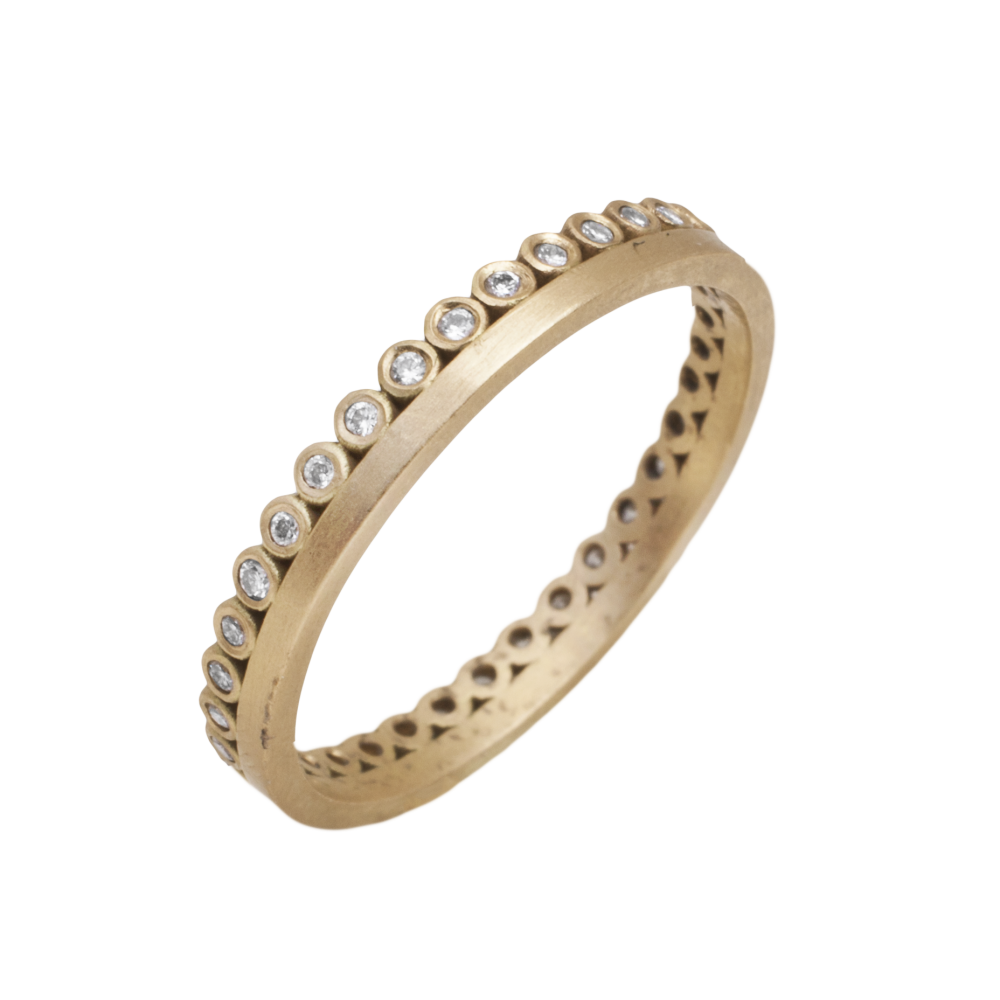 MATERIAL: 18k Yellow Gold   ORIGIN: USA  THE ROMANCE: An easy 18k yellow gold band from Ananda Khalsa gets a dose of sparkle fused with a 18k yellow gold eternity band of white diamonds.   SIZE: