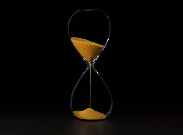 time and the hourglass black and white background