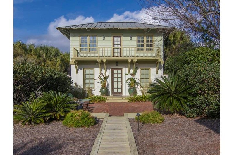 Lush Landscaping Surrounds Palmetto Retreat A Two Bedroom One Bath Cottage In Carillon House Rental Cottage Rental Beach House Rental