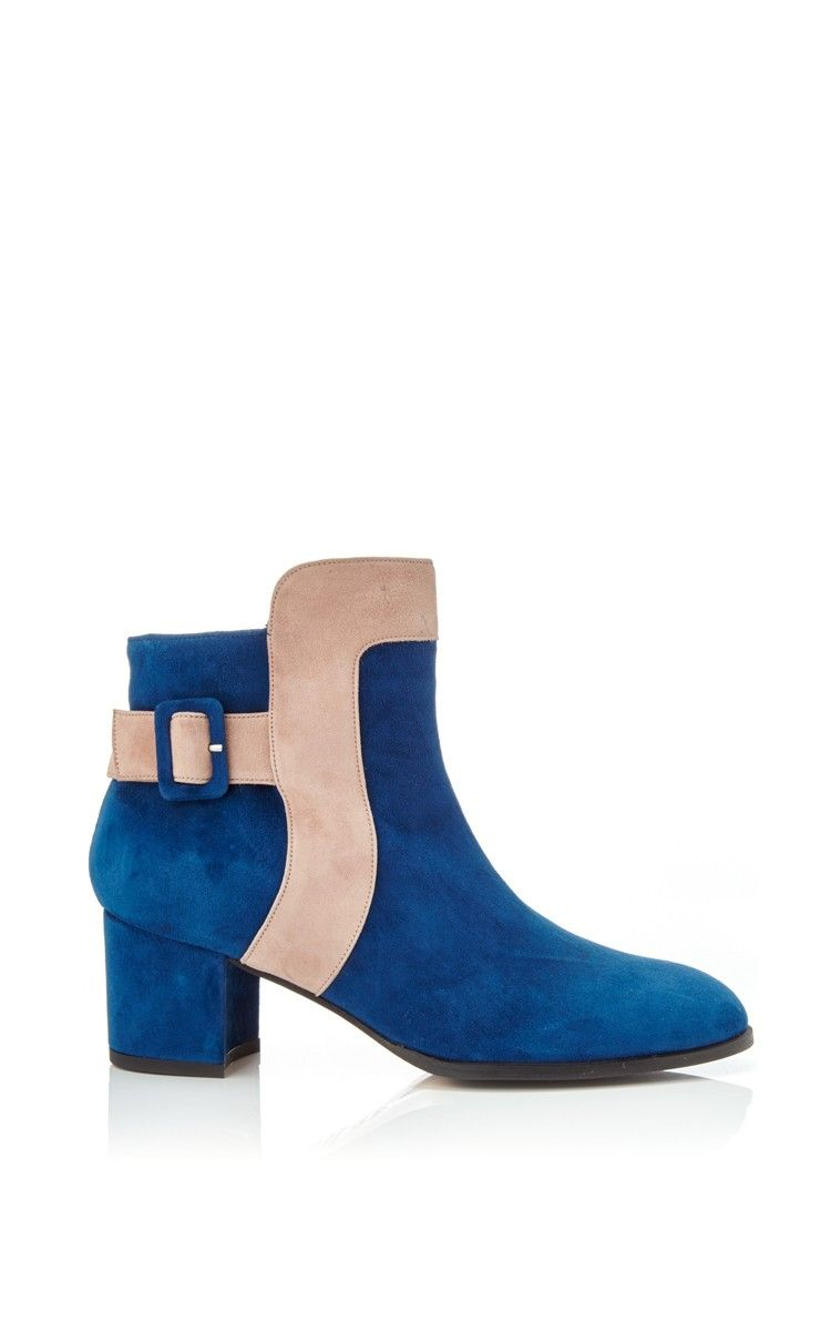 53ad0e325d288 This M'O Exclusive ankle boot by Carmelinas is rendered in marine blue suede  a pale pink trim and finished with a buckle detail.