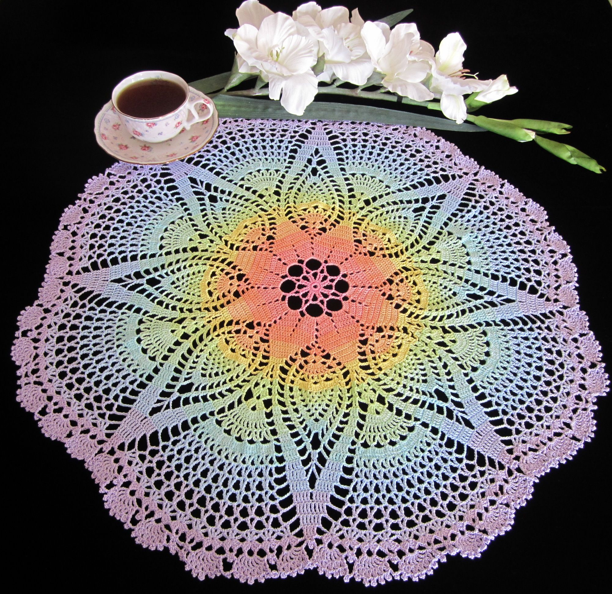 Rainbow crocheted doily made using hand-dyed thread in a variety of colors made by Pamela Humphreys (Raine59)