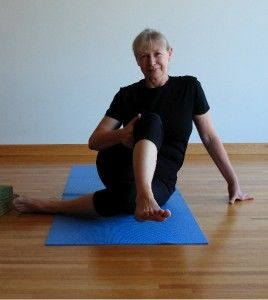 sit like a pretzel to stretch your hips with images