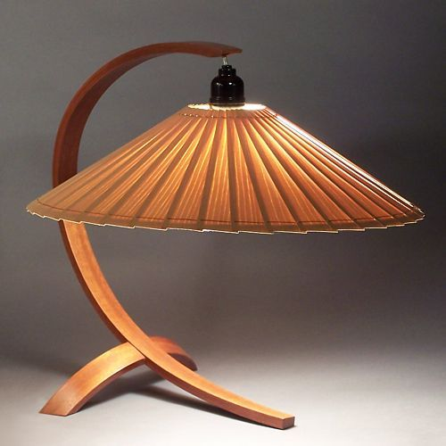 mahogany arched table lamp designed by John Lang with a shade of ash slats