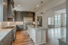 kitchen layout.  super wide commercial fridge, sink in island.