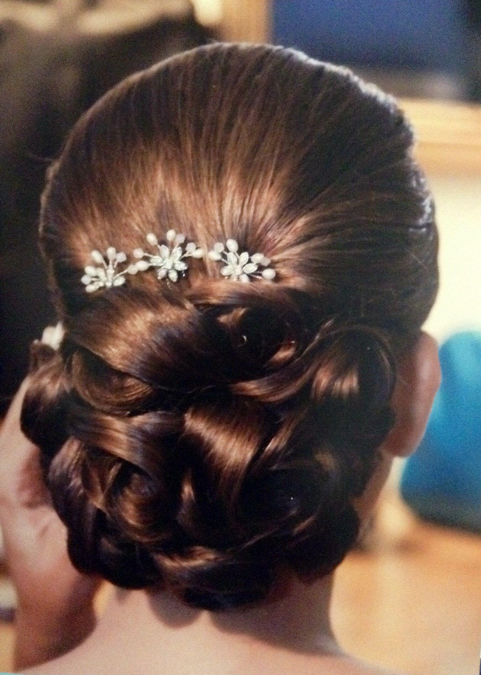 Peinado de novia clásico, moña baja
