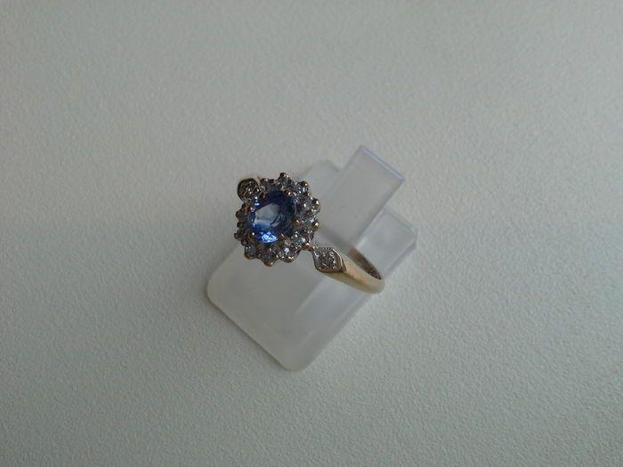Online veilinghuis Catawiki: Oude entourage ring met blauwe saffier en diamant 0.12ct