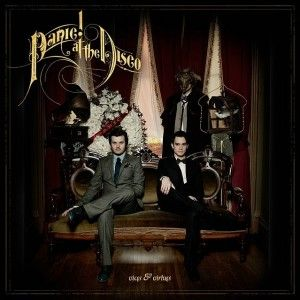 Panic! At The Disco's album cover for Vices & Virtues displays different shades in cool and neutral colors that are offset by different tints of cream in the background.