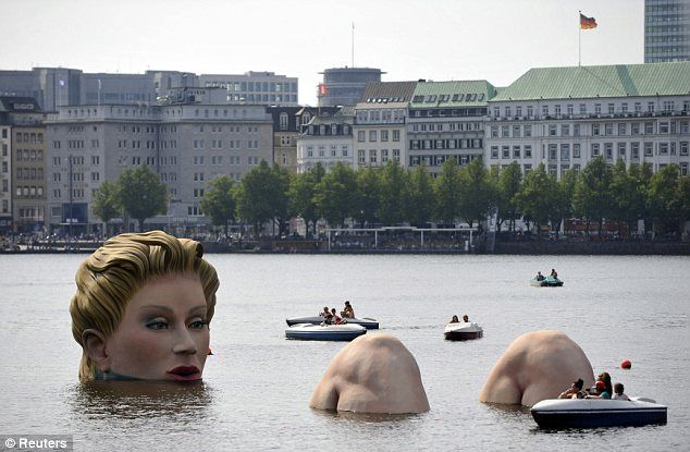 LADY OF THE LAKE. The giant 'mermaid' was on show at the Alster Lake in Hamburg. The idea of a mermaid was the inspiration for the artwork, although it looks as if the sculpture has knees instead of a fish tail. However, it is a very unique and cool piece of art and reinforces the cultural differences to mermaids and their legends.